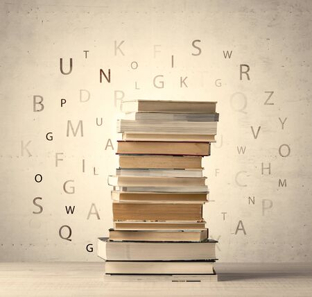 old letters: Books with flying letters on vintage old background Stock Photo
