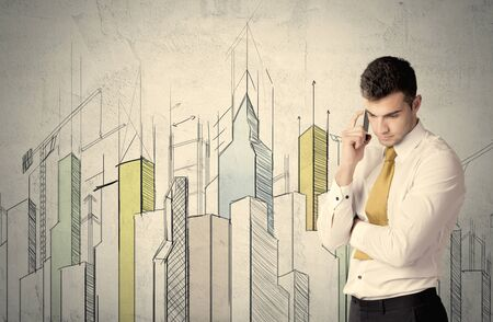 exponential: A young adult businessman standing in front of a wall with colorful drawings of buildings, charts, graphs, signs