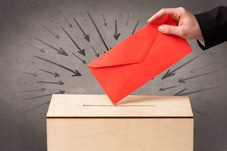 balloting: close up of a ballot box and casting vote on grungy background Stock Photo
