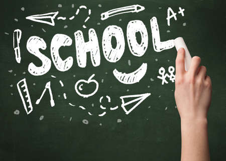 hand writing: A teacher writing school, drawing children things on clean green chalkboard by hand Stock Photo