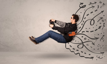man flying: Funny man driving a flying vehicle with hand drawn lines after him concept Stock Photo