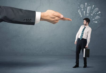 you are fired: Employee in trouble getting last warning from boss concept with big business hand pointing at salesman and drawn exclamation marks Stock Photo