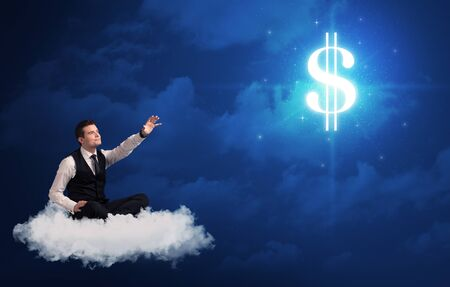 wondering: Caucasian businessman sitting on a white fluffy cloud wondering about huge money sign