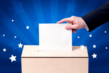 voting: Voting hand with ballot and wooden box