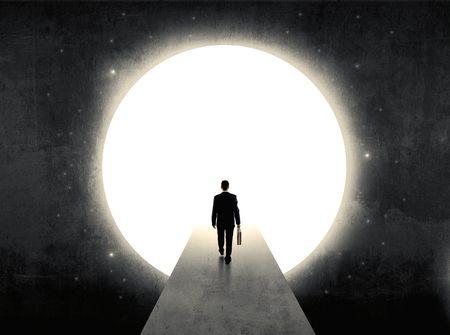 moon gate: businessman standing in front of the huge circle gate Stock Photo