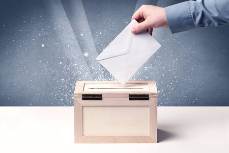 voter registration: Ballot box with person casting vote on sparkling background