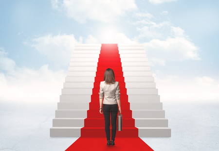 woman stairs: Businesswoman looking at stairs to heaven