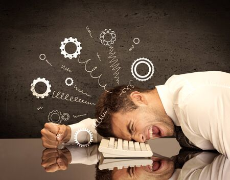 banging: Falling apart illustration concept with cranks, cog wheels springing from a fed up and tired businessmans head resting on laptop keyboard Stock Photo