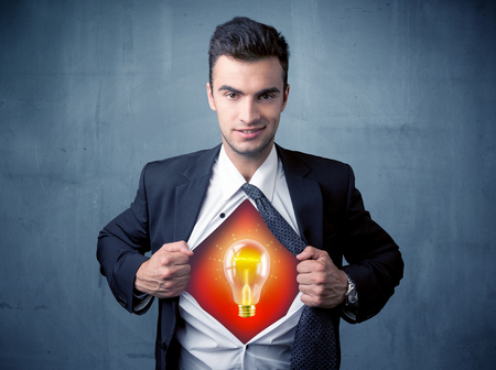 appears: Businessman ripping off shirt and idea light bulb appears on his chest concept on backround