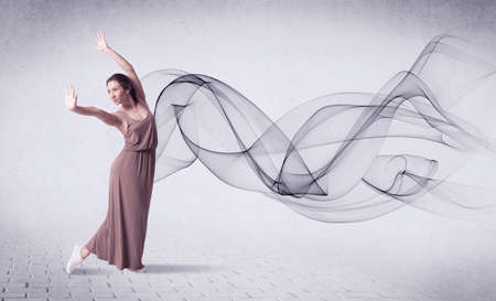 Modern ballet dancer performing with abstract swirl concept on background Stock Photo