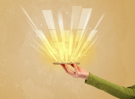 escaping: A caucasian hand holding a tablet phone with light beams and information escaping the device illustration concept