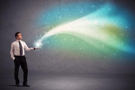 stria: Caucasian businessman holding aurora borealis kind of stria of light