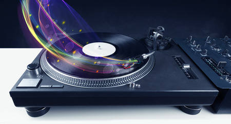 audiophile: Turntable playing vinyl with glowing abstract lines concept on background