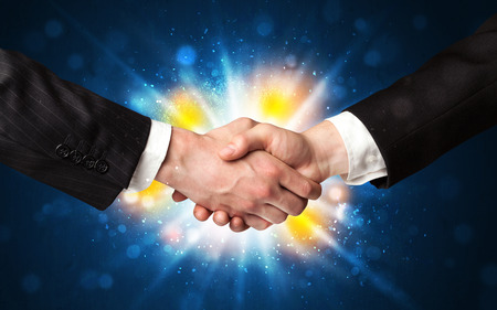 blow: Two business men shaking hands with a successes agreement with explosion