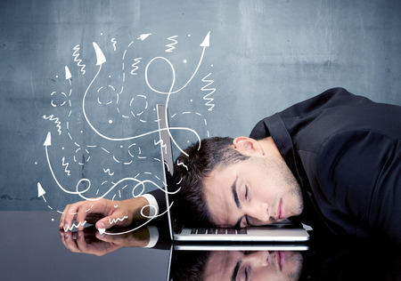 banging: A depressed businessman resting his head on a keyboard and shouting with illustration of ideas, arrows, lines leaving his head concept