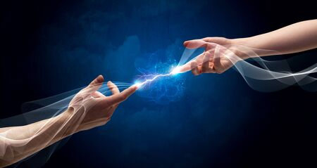 electric current: Two male arms reaching for each other, with a smoking electric current connecting their fingers in empty space background concept Stock Photo