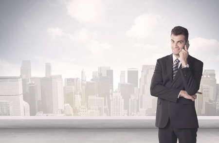 clouds scape: A young adult businessman standing in front of city landscape with skyscraper buildings and clouds concept