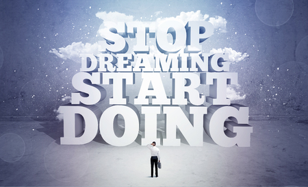 emty: A lazy sales person standing in emty space with huge block letters illustration saying stop dreaming start doing and clouds concept