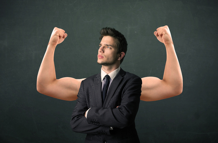 wondering: Young businessman wondering with strong and muscled arms concept
