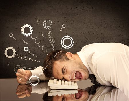 falling apart: Falling apart illustration concept with cranks, cog wheels springing from a fed up and tired businessmans head resting on laptop keyboard Stock Photo
