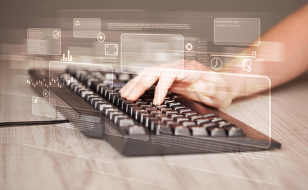 high tech: Hand touching keyboard with high tech button screen Stock Photo