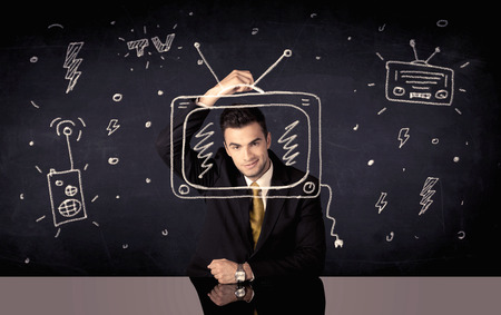 programme: An elegant happy businessman drawing a television around his face, dreaming about becoming a famous actor or a programme presenter concept Stock Photo