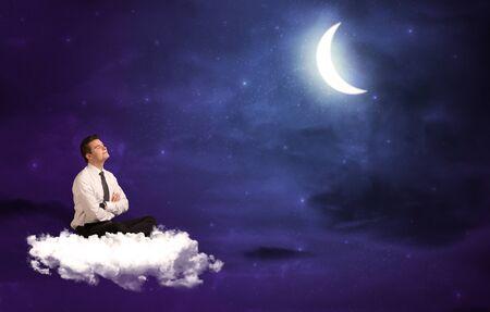 wondering: Caucasian businessman sitting on a cloud, wondering