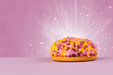 coloful: Sparkling tasteful home made sugar cake with coloful background Stock Photo