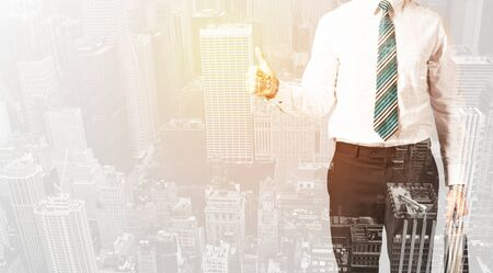 warm color: Business man with warm color overlay of city background texture