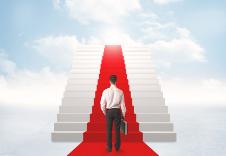 elegant staircase: Businessman looking at stairs to heaven
