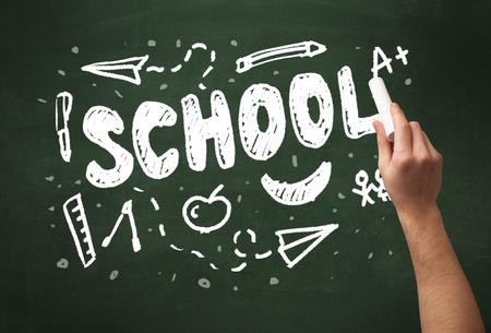 green chalkboard: A teacher writing school, drawing children things on clean green chalkboard by hand Stock Photo