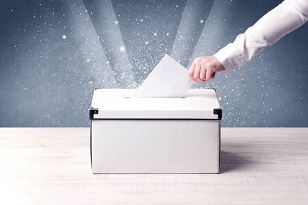 balloting: Ballot box with person casting vote on sparkling background