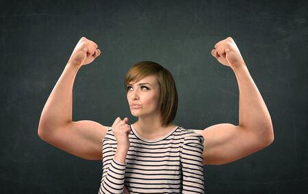gesticulation: Pretty young woman with strong and muscled arms concept