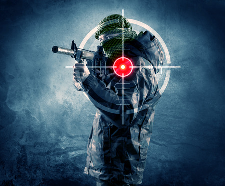 Masked terrorist man with gun and laser target on his body concept Stock Photo