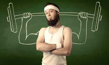 imagining: A young man with beard and glasses posing in front of green background, imagining how he would lift weight with big muscles, illustrated by white drawing concept. Stock Photo