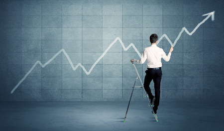 digitally: A man standing on a ladder and drawing a chart on blue wall background with exponential progressing curve, line