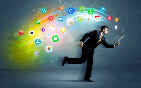 Running businessman with colorful application icons from media device