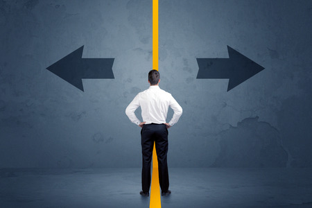 Business person choosing between two options separated by a yellow border arrow concept Stock Photo