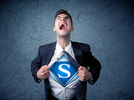 his: Businessman ripping off his shirt with superhero sign on his chest concept on background