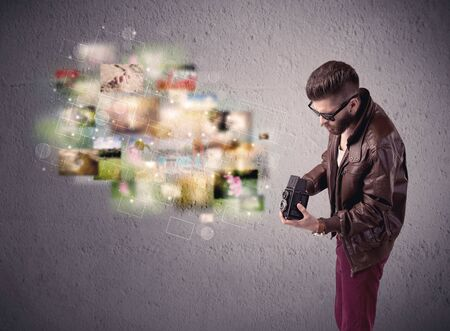 capturing: A funny stylish hipster guy capturing moments and memories with a retro photo camera illustration concept