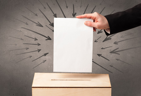 voter registration: close up of a ballot box and casting vote on grungy background Stock Photo
