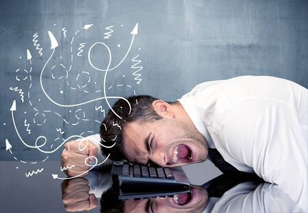 hit tech: A depressed businessman resting his head on a keyboard and shouting with illustration of ideas, arrows, lines leaving his head concept