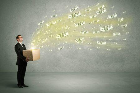 ユーロ ドル札、箱から出して飛んで入りお金の概念をたくさん作って成功した若い営業担当者は、彼の手で開催。