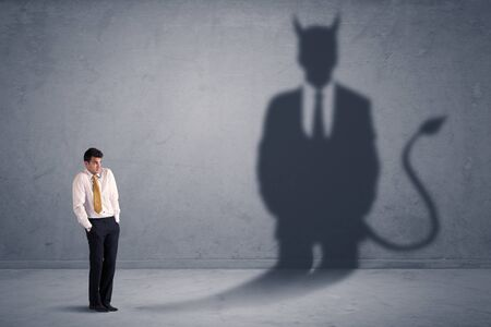 hoax: Business man looking at his own devil demon shadow concept background