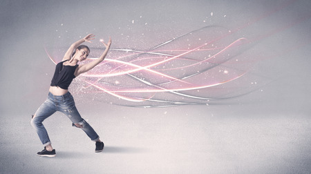 A pretty hip hop dancer dancing contemporary dance illustrated with glowing motion lines in the background concept.