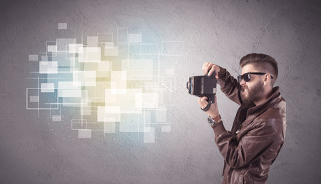 capturing: A funny stylish hipster guy capturing bright moments and glowing square pictures with a vintage photo camera illustration concept