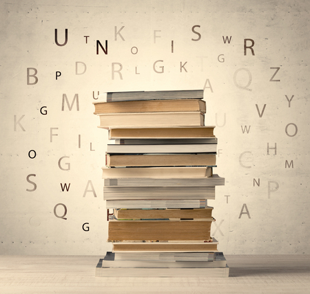 Books with flying letters on vintage old background Stock fotó