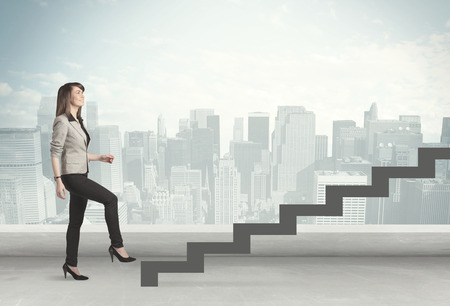 Business person in front of a staircase, city on the background photo