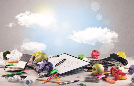 pencils  clutter: Close up of business office desk concept with clouds, blue sky and sunshine