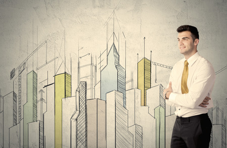 young adult: A young adult businessman standing in front of a wall with colorful drawings of buildings, charts, graphs, signs
